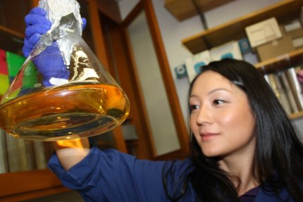 Graduate student and study lead author Eun-Hae Kim checks on a flask
