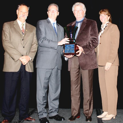 Presentation of Bergstein Messenger Award to the Race Track Industry Program at its annual Symposium on Racing and Gaming, (l to r): Steve Barham, RTIP lecturer; Paul Fontaine, Harness Tracks of America president; Doug Reed, RTIP director; and Wendy Davis, RTIP lecturer.