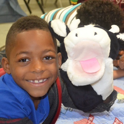 Kids participating in the OMK Creative Safari program used animal puppets to share their experiences coping with the military deployment of a parent. (Photo by Teresa Noon)