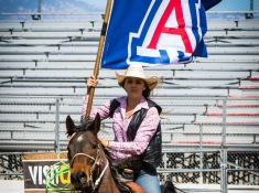 Sarah Nelson holding the UA flag. Photo Credit: Gilson Photo