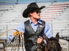 Tanner Lyman during roping competition. Photo Credit: Gilson Photo