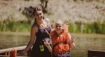 A Maricopa County 4-H member is with Program Coordinator, Hannah Hanson on the lake at James 4-H Camp and Outdoor Learning Center.