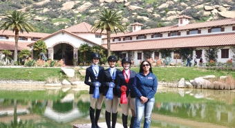 Equestrian riders with ribbons