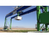 The world's largest robotic field scanner (white steel box) is mounted on a 30-ton steel gantry moving along 200-meter steel rails over 1.5 acres of energy sorghum at the Maricopa Agricultural Center. (Photo: Susan McGinley)