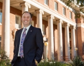 Shane Burgess stands in front of historic Forbes building on UA Main Campus