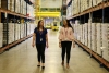 UArizona nutritional science students walk the warehouse floor at the Community Food Bank
