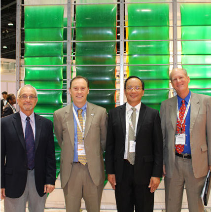 Standing in front of the Accordion photobioreactor developed at CALS and patented by the Arizona Board of Regents are (from left): Gene Giacomelli, director of the Controlled Environment Agriculture Center and professor of agricultural and biosystems engineering; Shane Burgess, vice provost and dean of CALS; Joel Cuello, biosystems engineering professor and UA liaison to the GFIA; and Kevin Fitzsimmons, professor of soil, water and environmental sciences. (Photo by Cody Lee Brown)