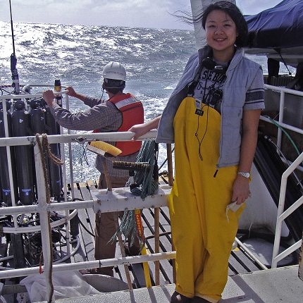 Li Deng, co-first author on the Nature paper, stands on the deck of the research vessel. (Photo: Sullivan lab)