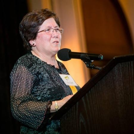 Sharon Megdal accepts the Lifetime Achievement Award at the Women of Influence event.