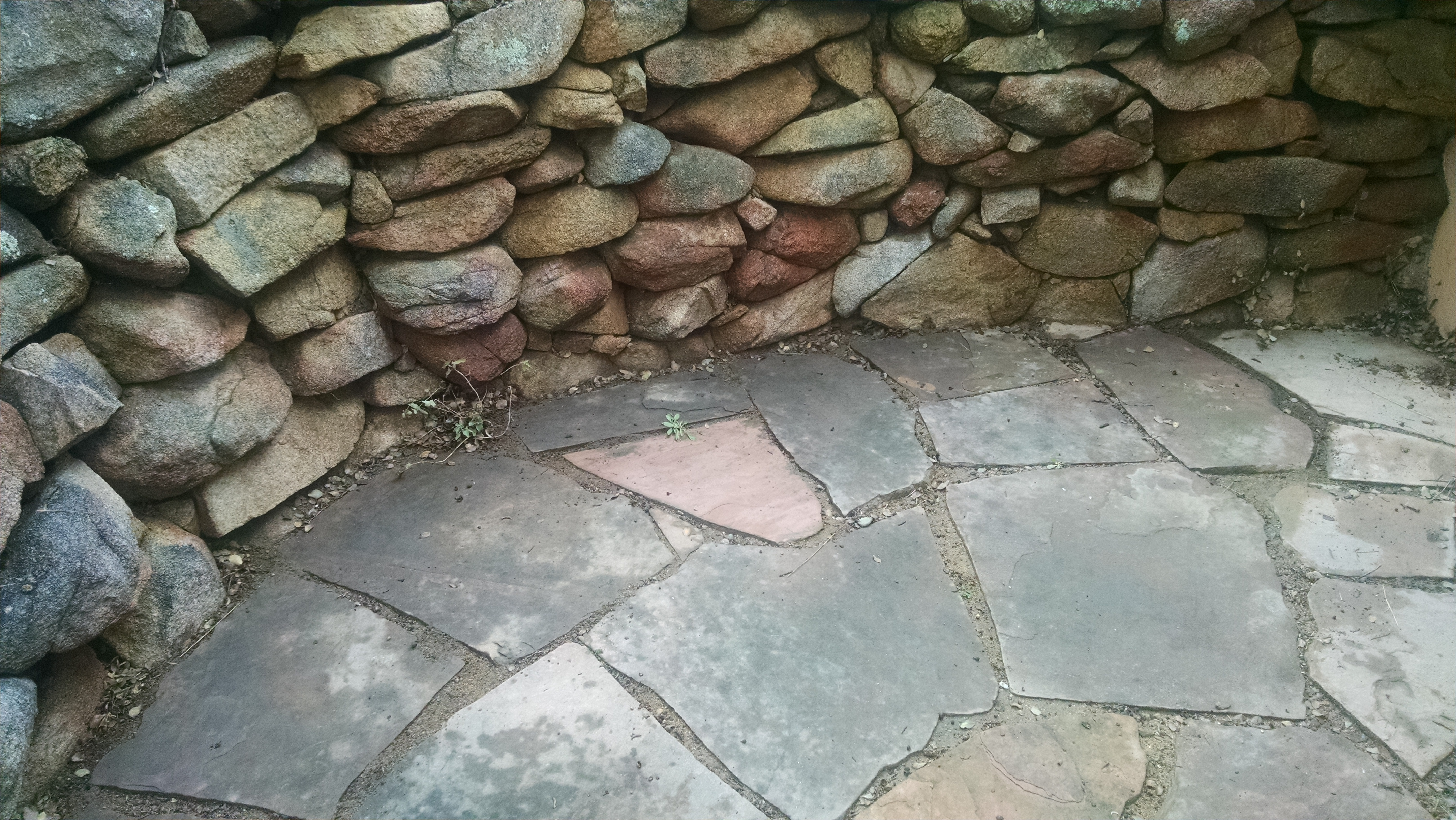 Backyard Gardener Using Flagstone In The Landscape January 11